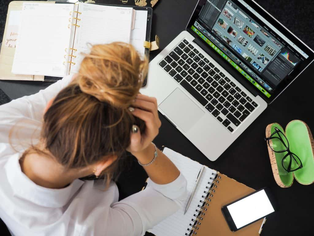 stressed woman at desk no motivation