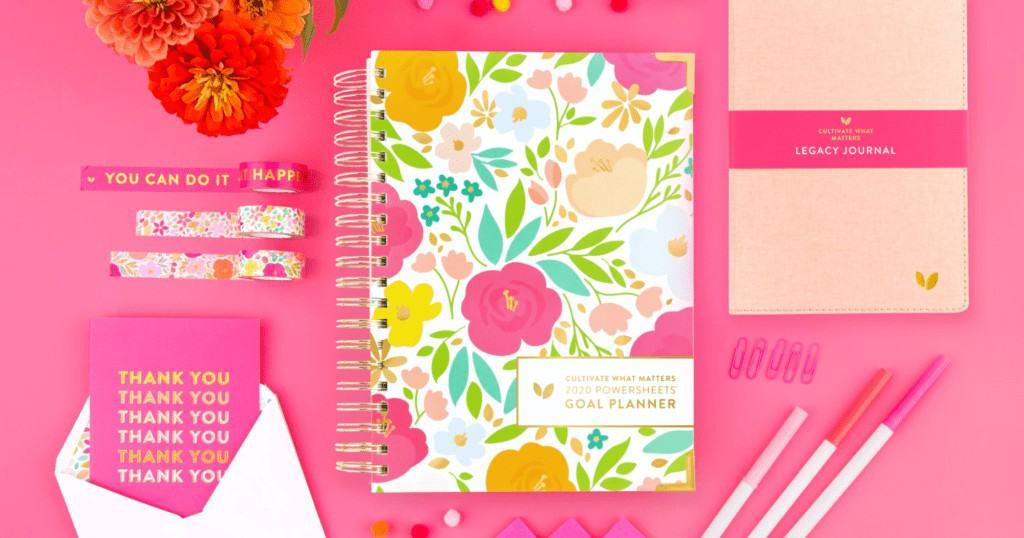goal planner in pink workspace