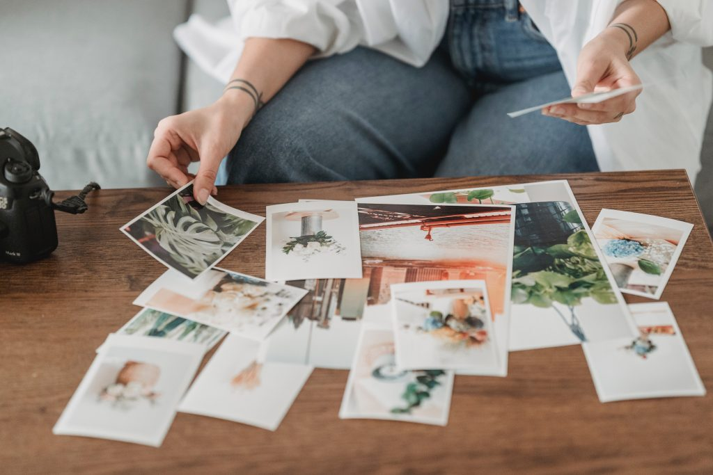 Photograph of a woman making a vision board collage