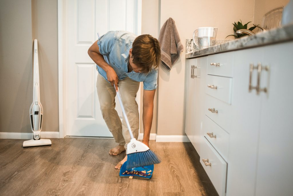 image of husband cleaning up
