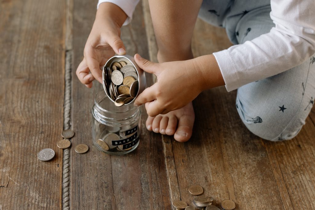 image of child with coins